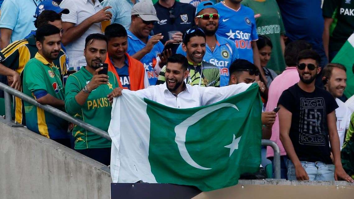 Boxer Amir Khan holds up a Pakistan flag in the stands during the 2017 ICC Champions Trophy Final on June 18, 2017. (Reuters)