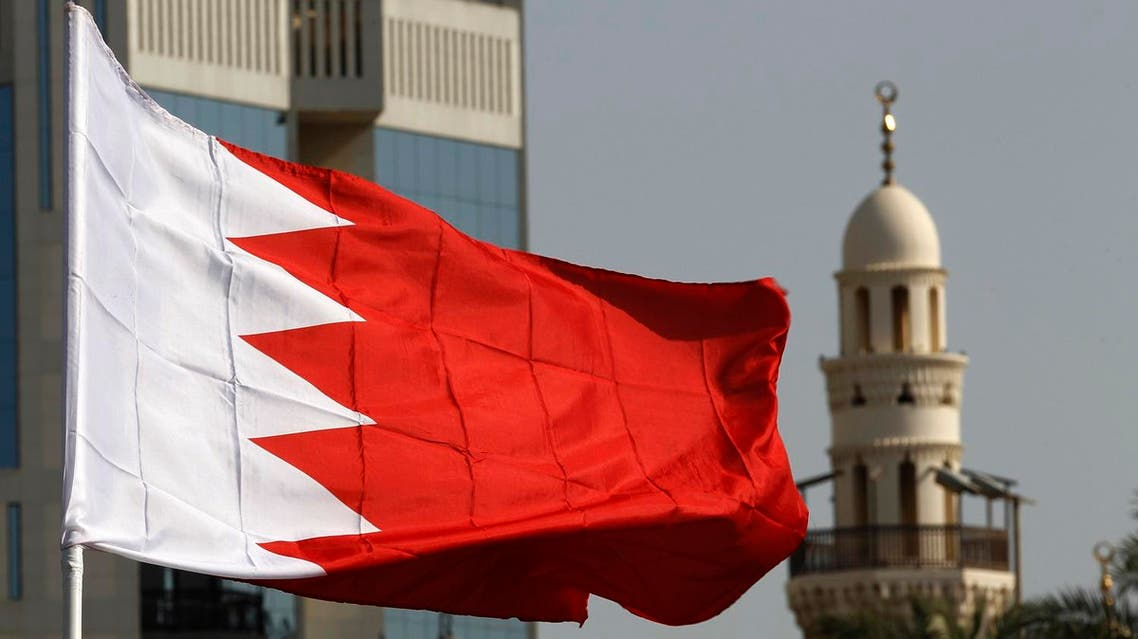 A Bahraini flag raised by protesters flutters in front of a local mosque during an anti-government demonstration at the Bahrain Financial Habour in Manama, March 7, 2011. Bahrain suffered its worst unrest since the 1990s last month when seven people died in a heavy-handed security response to protests by Shi'ites who have long complained of discrimination in Sunni-ruled Bahrain, a close U.S. and Saudi ally. REUTERS/Hamad I Mohammed