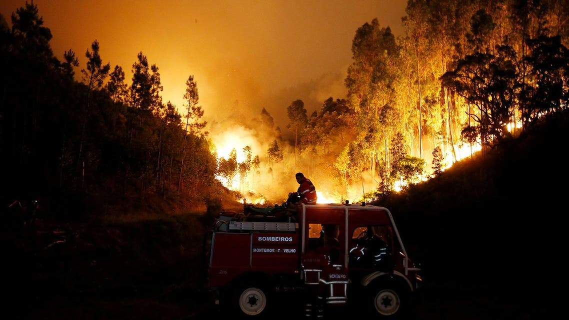 Firefighters work to put out a forest fire near Bouca, in central Portugal, on June 18, 2017. (Reuters)