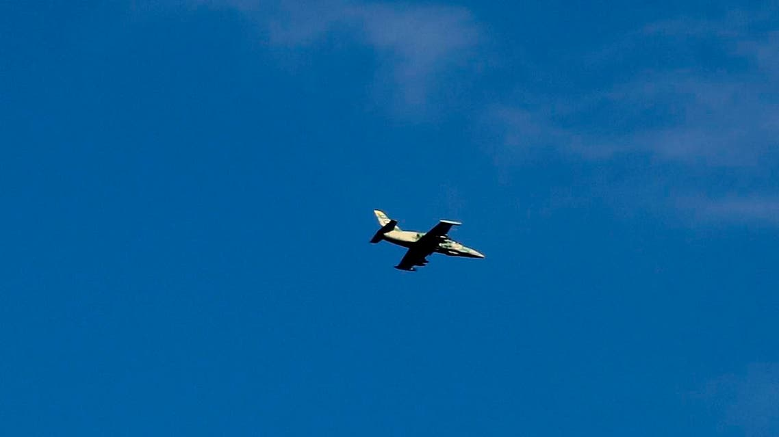 A Syrian war plane is seen flying over the village of Jibreen south of Aleppo, Syria. (File photo: AP)