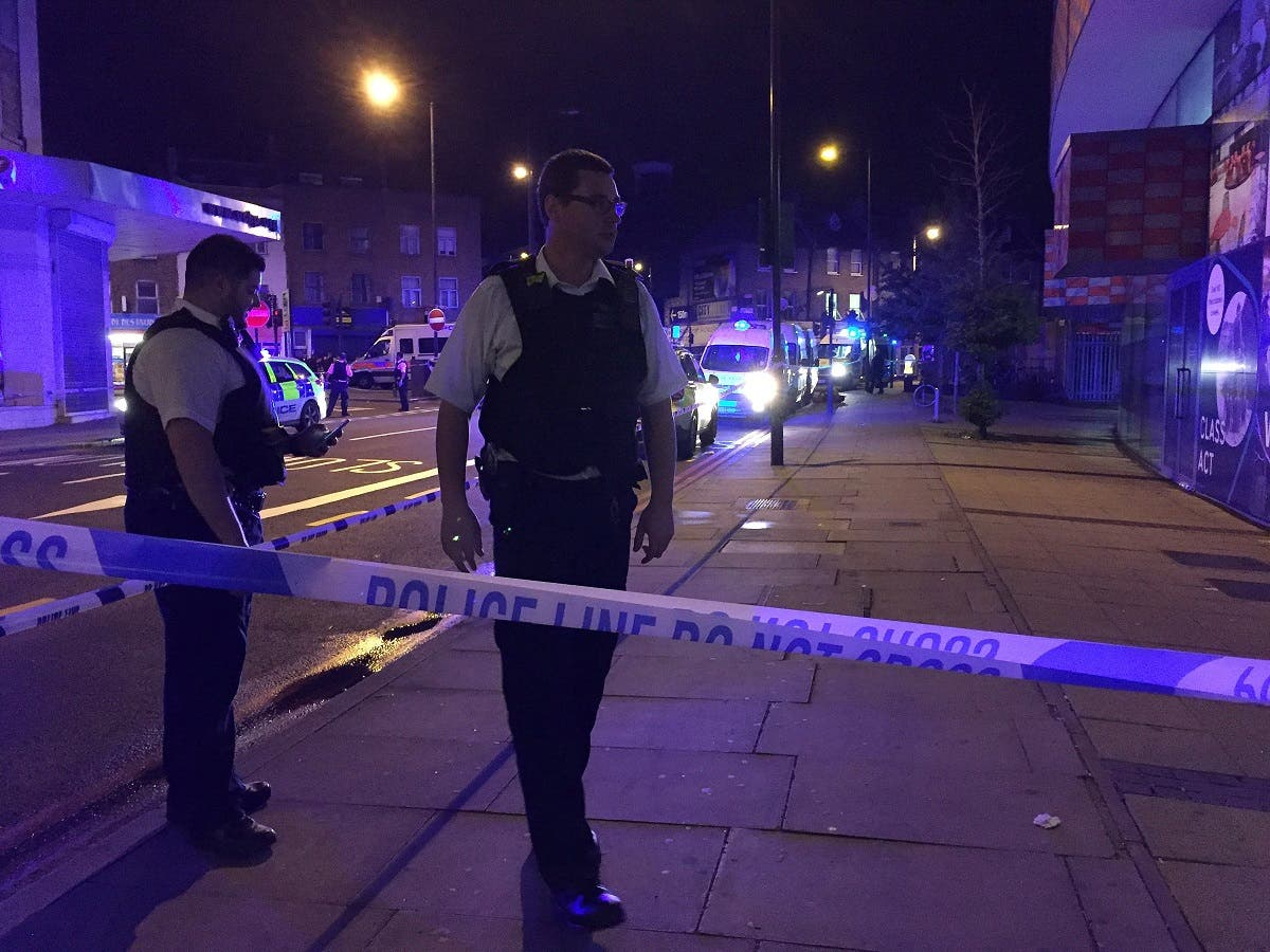 Police are seen near Finsbury Park as British police say there are casualties after reports of vehicle colliding with pedestrians in North London. (Reuters)