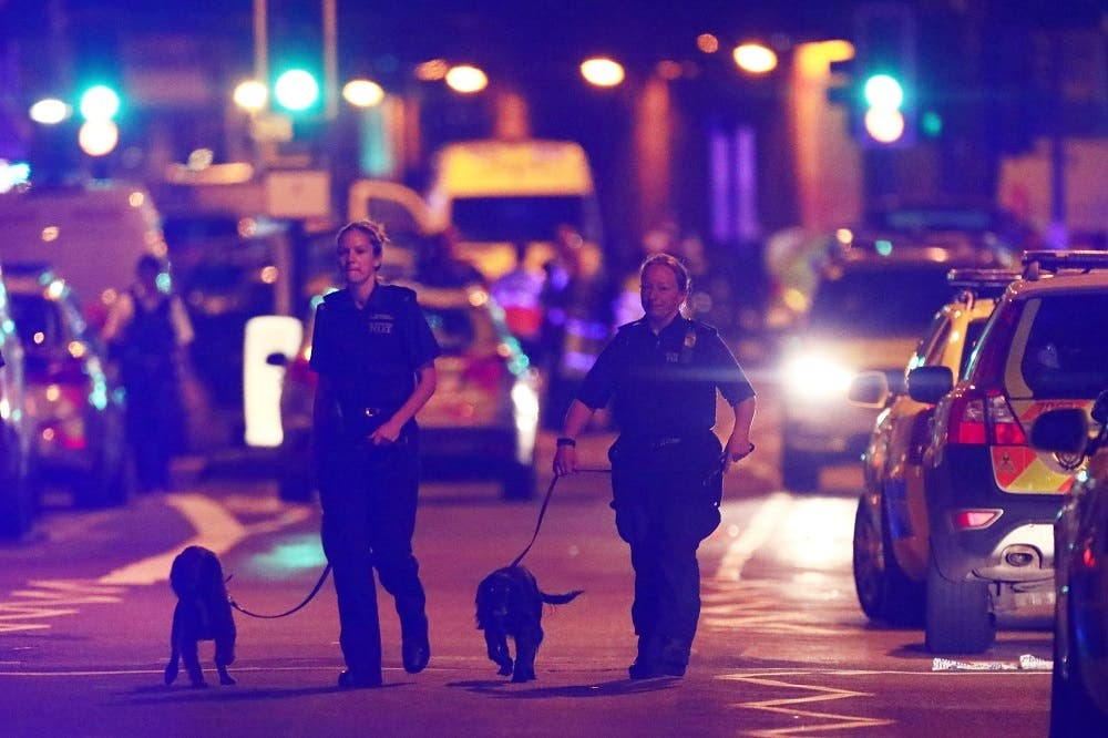 Police officers attend to the scene after a vehicle collided with pedestrians in the Finsbury Park neighbourhood of North London, Britain June 19, 2017. (Reuters)