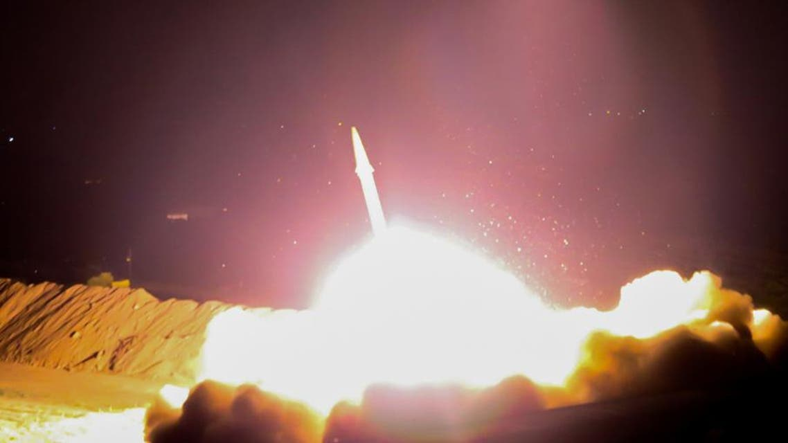 A handout picture shows the IRGC launching a missile from an undisclosed location towards ISIS in Syria. (AFP/IRIB TV)