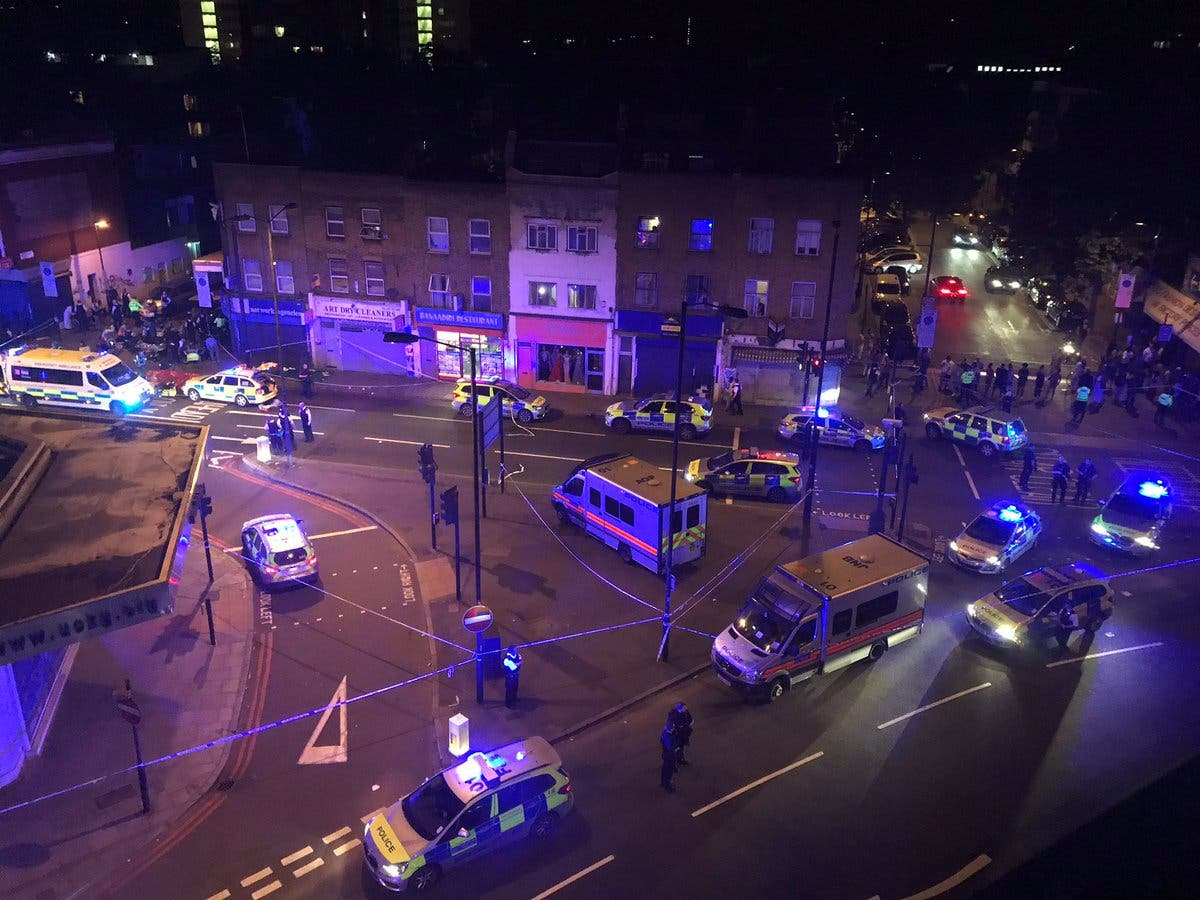 Police officers attend to the scene after a vehicle collided with pedestrians in the Finsbury Park neighborhood of North London. (Thomas Van Hulle/Social Media via Reuters)