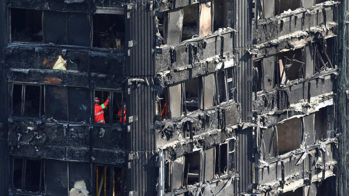 Members of the emergency services work inside burnt out remains of the Grenfell apartment tower in North Kensington, London, Britain, June 18, 2017. (Reuters)