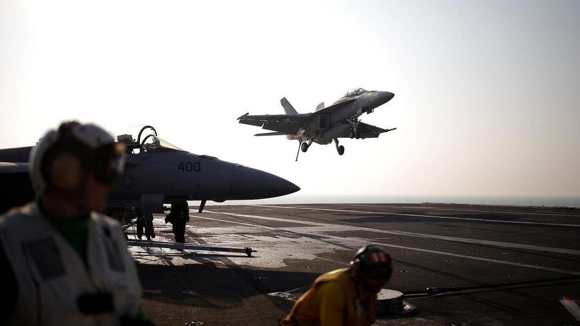 A U.S. Navy F/A-18 Super Hornet fighter lands onto the deck of the USS Ronald Reagan, a Nimitz-class nuclear-powered super carrier, during a joint naval drill between South Korea and the U.S., in the West Sea, South Korea, October 14, 2016.