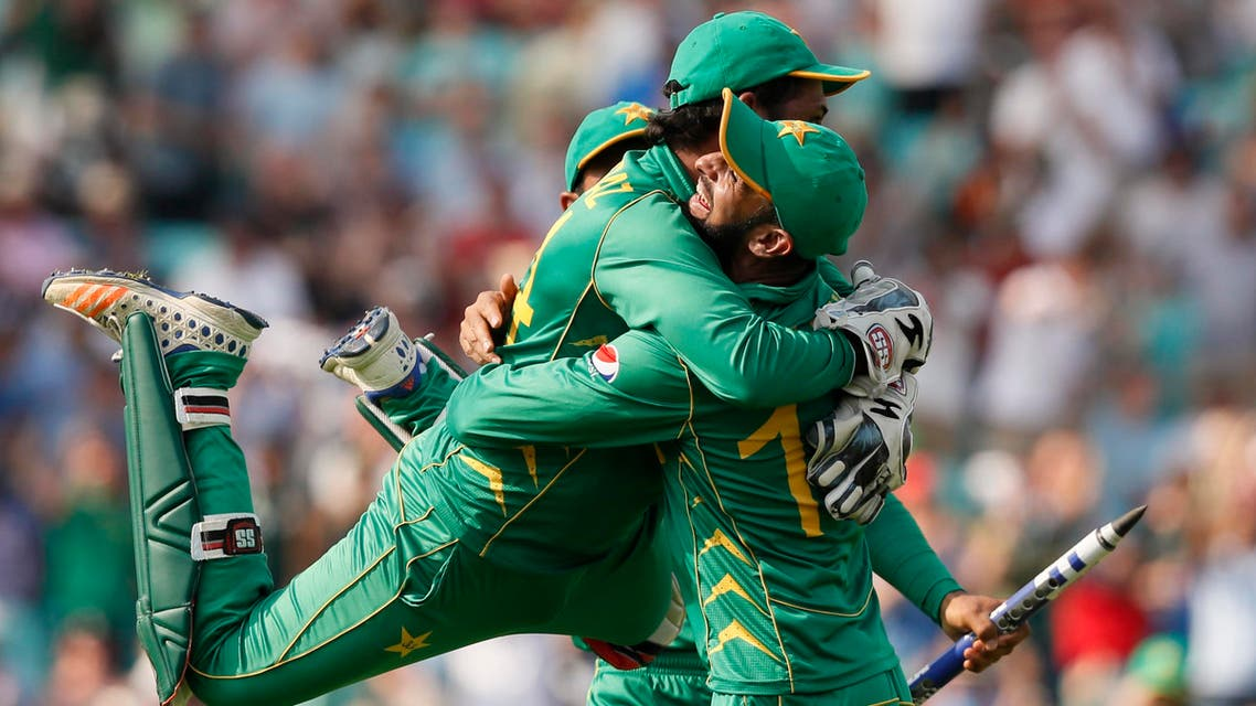 Pakistan's captain Sarfraz Ahmed, left, jumps over a teammate after they defeated India by 180 runs during the ICC Champions Trophy final at The Oval in London, Sunday, June 18, 2017. (AP)