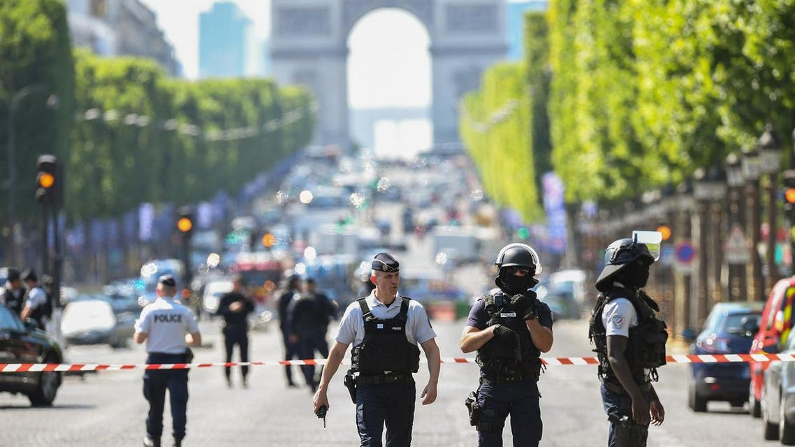 Police officers and anti-riot police officers patrol the Champs-Elysees avenue on June 19, 2017. (AFP)