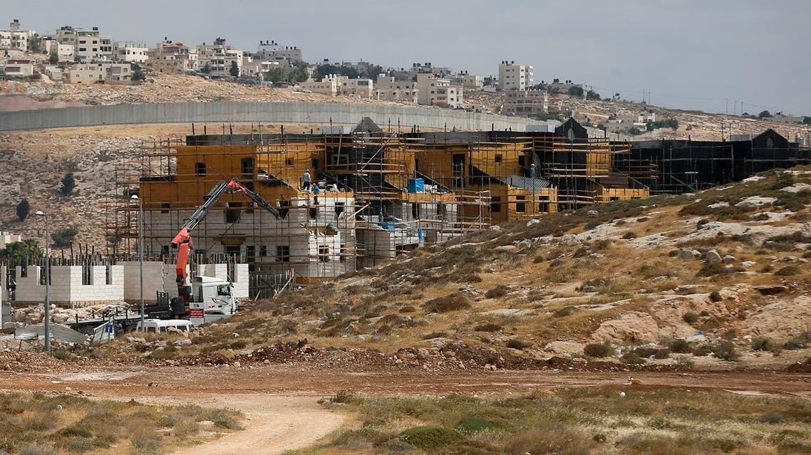 A picture taken on May 21, 2017 shows Israel's controversial barrier separating the Jewish settlement of Neve Yaakov (foreground) in the northern area of east Jerusalem and the Palestinian neighbourhood of al-Ram (background) in the West Bank. (AFP)