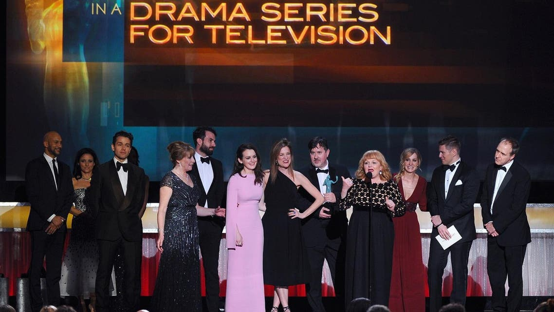 """Lesley Nicol (foreground), and the cast and crew of """"Downton Abbey"""" accept the award for outstanding ensemble in a drama series at the 22nd annual Screen Actors Guild Awards at the Shrine Auditorium & Expo Hall on Saturday, Jan. 30, 2016, in Los Angeles. (AP)"""