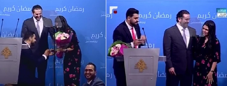 Poet Bilal al-Meer kneels to put a wedding ring on Dina Drawish's finger in the presence of Lebanese Prime Minister, Saad al-Hariri. (Supplied)