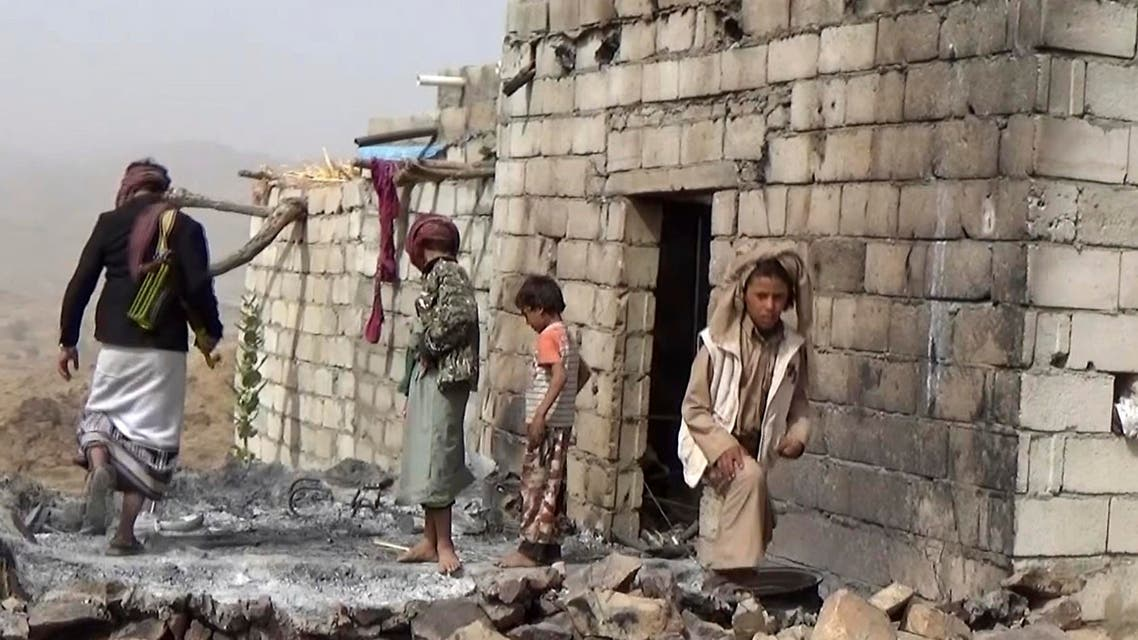 In this Feb. 3, 2017 frame grab from video, residents inspect a house that was damaged during a Jan. 29, 2017 US raid on the tiny village of Yakla, in central Yemen. ap