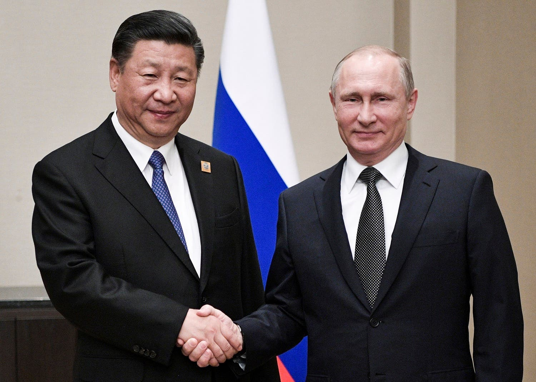 Russian President Vladimir Putin and Chinese President Xi Jinping shake hands at their meeting in Astana, Kazakstan, on June 8, 2017. (AP)