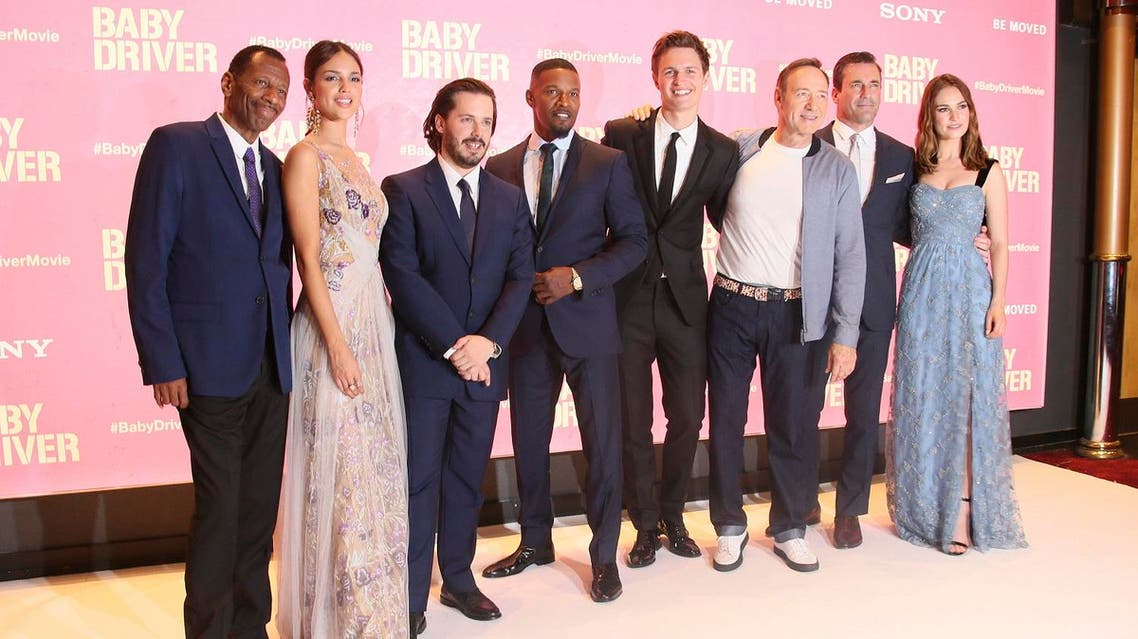 Actors from left to right , CJ Jones, Eiza Gonzalez, Director Edgar Wright, Jamie Foxx, Ansel Elgort, Kevin Spacey, Jon Hamm, and Lily James pose for photographers upon arrival at the premiere of the film 'Baby Driver' in London, Wednesday, June 21, 2017. (AP)
