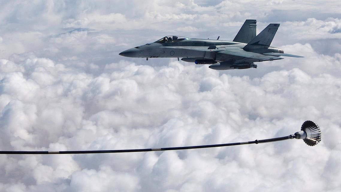 A supplied image of a Royal Australian Air Force F/A-18A Hornet refuelling from a KC-30A Multi Role Tanker Transport in the skies over the Middle East region April 22, 2016. Picture taken April 22, 2016. (Reuters)