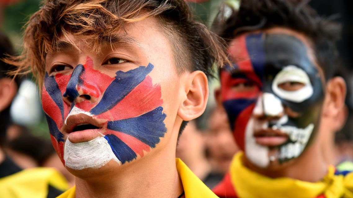 Tibetans living in exile stage a demonstration during the 58th Anniversary of the Tibetan National uprising day, in Bangalore on March 10, 2017. (AFP)