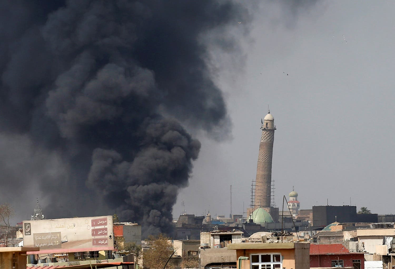 Smoke rises from clashes near Mosul's Al-Habda minaret at the Grand Mosque, March 17, 2017. (Reuters)