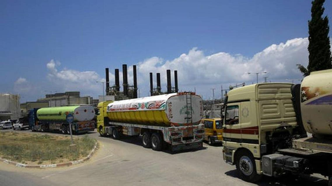 Egyptian trucks carrying fuel enter Gaza's power plant in Nusseirat, in the central Gaza Strip, Wednesday, June 21, 2017. (AP)