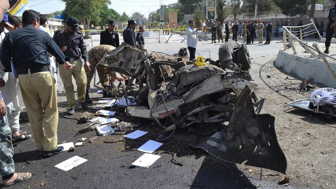 Pakistani police officers examine the site of an explosion in Quetta, Pakistan, Friday, June 23, 2017. (AP)