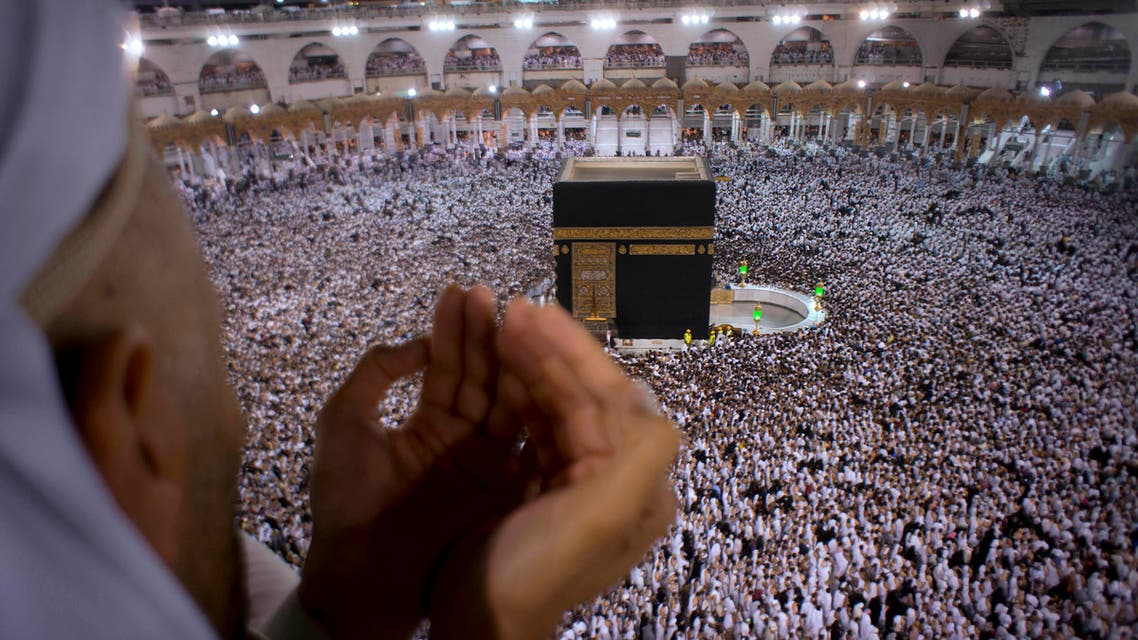 A Muslim worshipper prays during Laylat al-Qadr, Night of Decree, on the 27th day of the holy fasting month of Ramadan as pilgrims circumambulate around the Kaaba, the cubic building at the Grand Mosque, during the minor pilgrimage, known as Umrah, in the Muslim holy city of Mecca, Saudi Arabia, early Thursday, June 22, 2017. (AP)