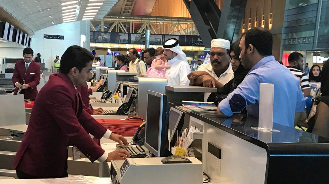 In this Monday, June 12, 2017 photo, Qatari and other nationals queue at the check in counters of the Hamad International Airport in Doha, Qatar. (AP)