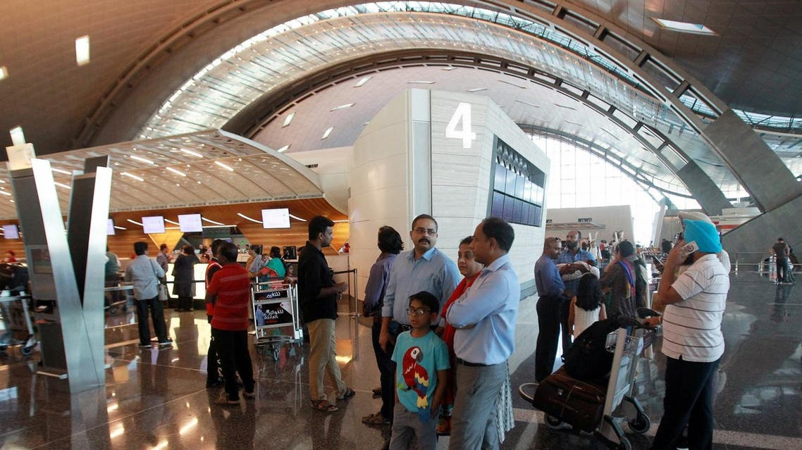 Passengers at Hamad International Airport in Doha, Qatar, on June 12, 2017. (Reuters)