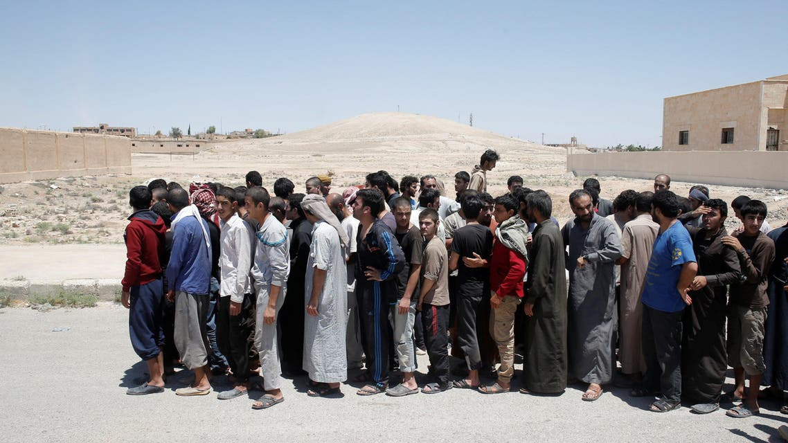 Islamic State prisoners, who were pardoned by a council that is expected to govern Raqqa once the group is dislodged from the Syrian city, stand in Ain Issa village, north of Raqqa, Syria June 24, 2017
