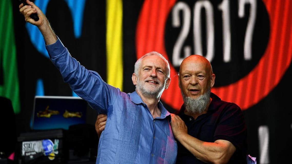 Britain's opposition Labour Party leader Jeremy Corbyn and Michael Eavis acknowledge the crowd at Worthy Farm in Somerset during the Glastonbury Festival. (Reuters)