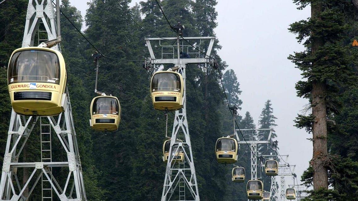 Tourists enjoy cable-car rides at the tourist resort of Gulmarg, 31 miles north of Srinagar, India. (AP)