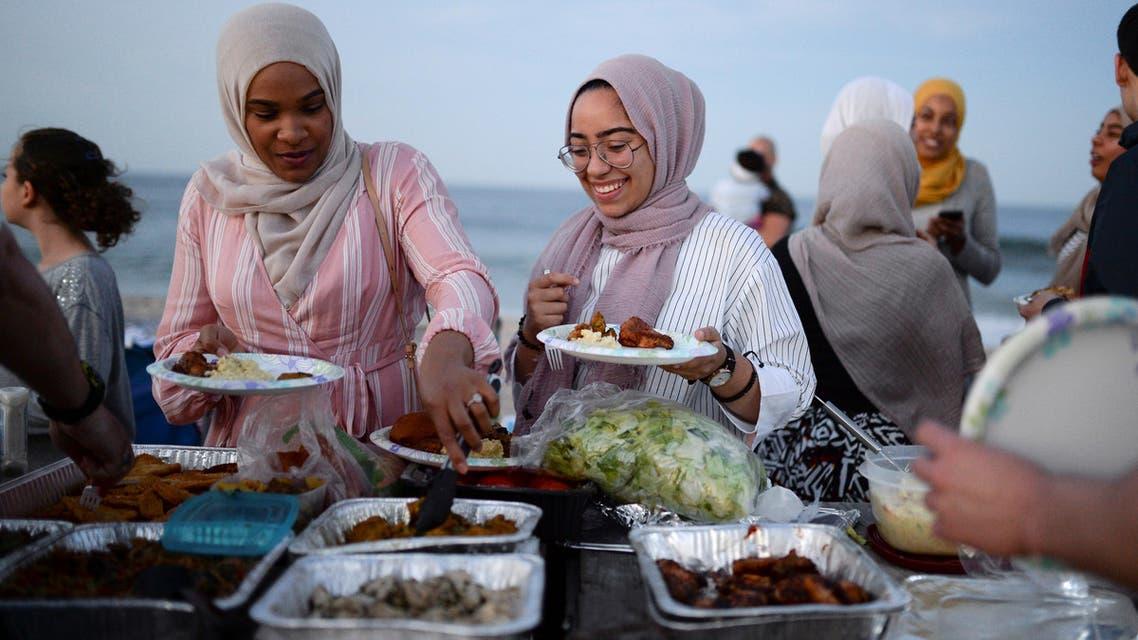 Muslim American friends take part in the last Iftar of Ramadan, ahead of Eid al-Fitr celebrations, on a beach in Long Branch, New Jersey, U.S., June 24, 2017. REUTERS/Amr Alfiky