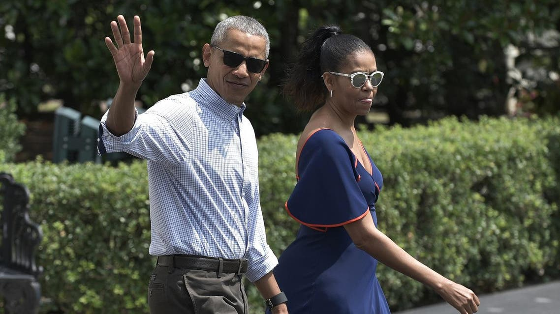 US President Barack Obama and First Lady Michelle Obama make their way to board Marine One on the South Lawn of the White House in Washington, DC on August 6, 2016. Obama and his family were headed to Martha's Vineyard for their summer vacation. (AFP)