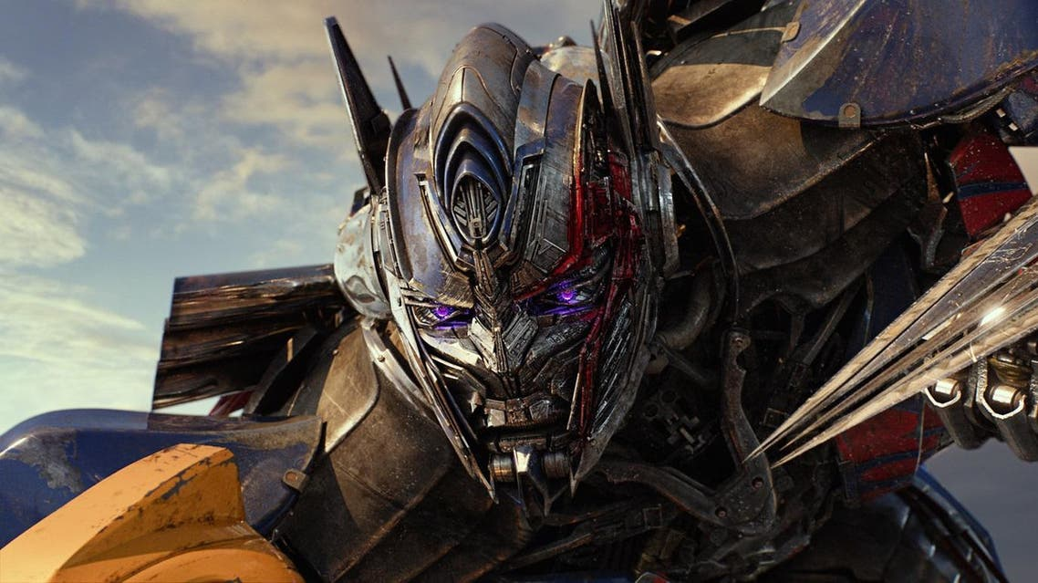 """This image released by Paramount Pictures shows Megatron and Josh Duhamel as Lennox in a scene from, """"Transformers: The Last Knight."""" (Paramount Pictures/Bay Films via AP)"""