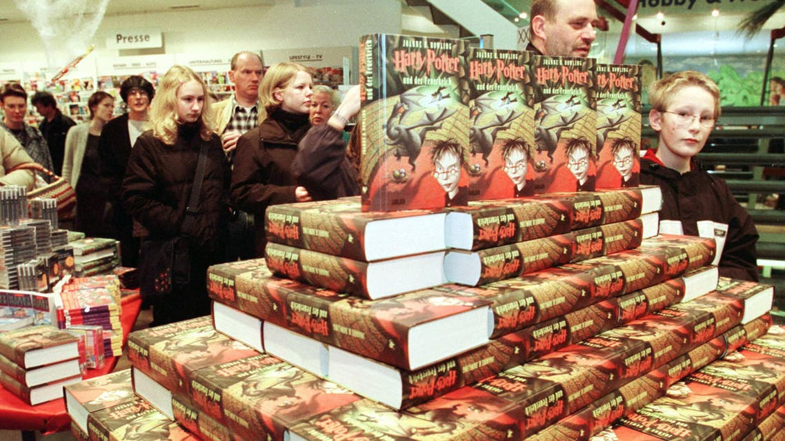 At 8 am customers stand in line at a bookstore in Bremen, northwest Germany, to buy the forth title of Scotish novelist J.K. Rowling's Harry Potter books on Saturday, October 14, 2000. (AP)