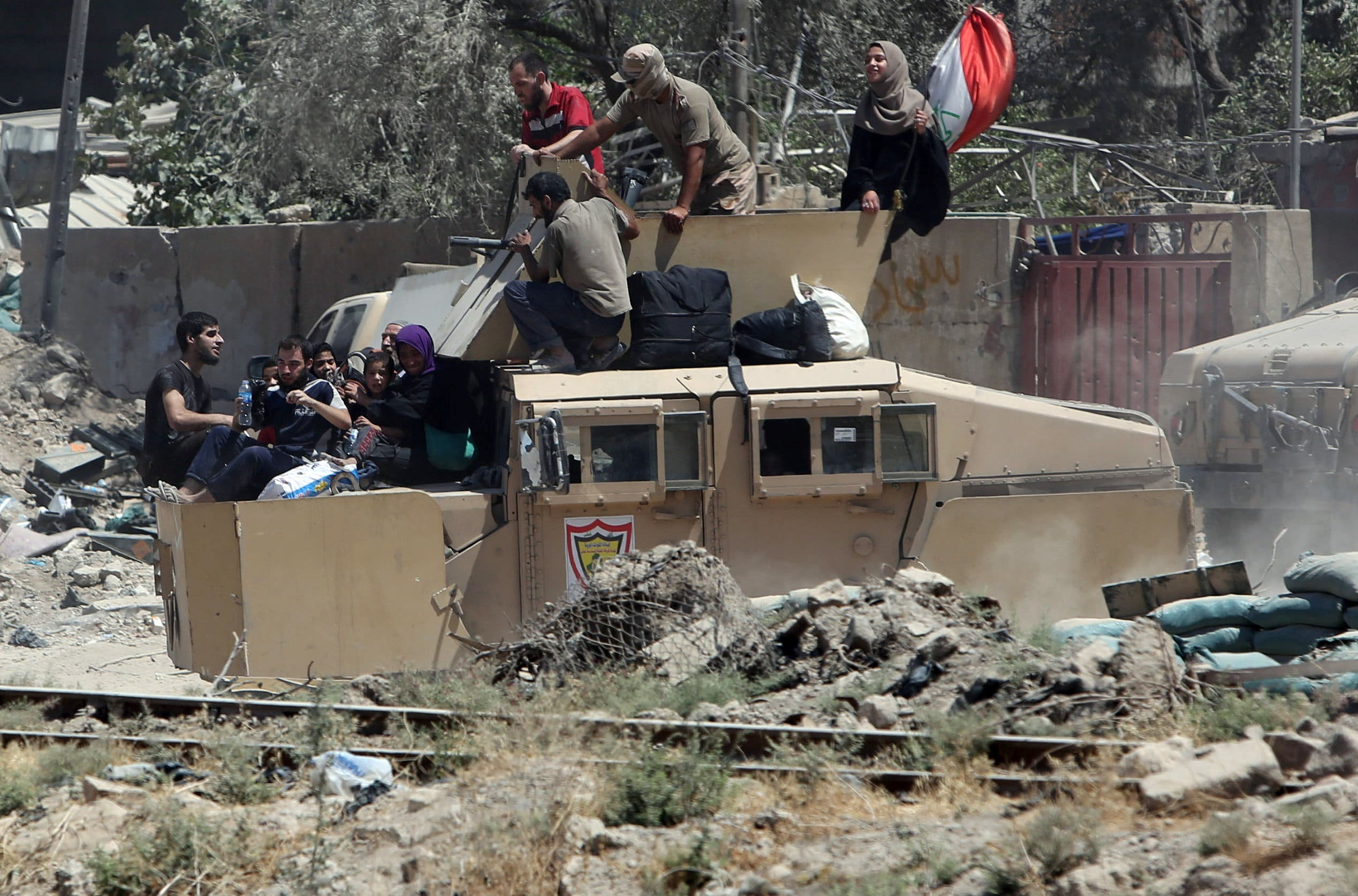 Iraqi security forces transport displaced civilians with an armoured fighting vehicle out of West Mosul during fighting with Islamic State militants in the Old City of Mosul, Iraq June 24, 2017. (Reuters)