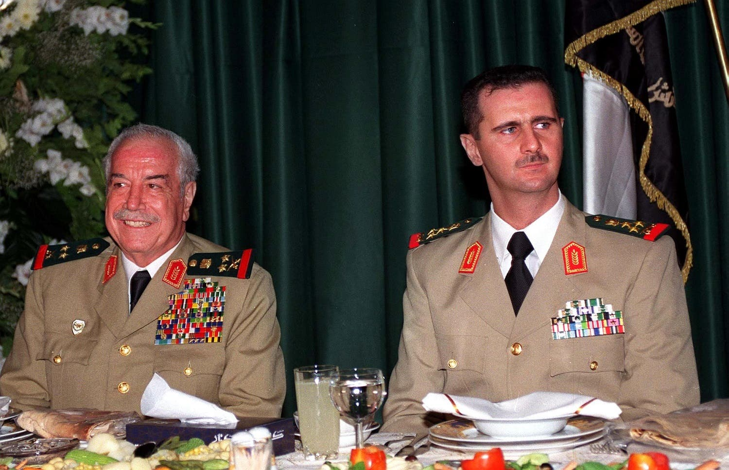This handout file picture released on August 02, 2000 by the official Syrian News Agency (SANA) shows then Defence Minister Mustafa Tlass and Syrian President Bashar al-Assad (R) during a dinner in Damascus to marking the Army Day. Mustapha Tlass died at a hospital in Paris on June 27, 2017 at the age of 85, his son told AFP. (AFP)