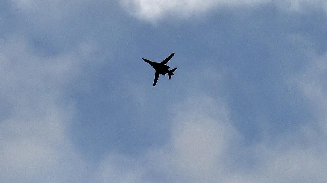 A US Air Force B-1 Lancer bomber flies over the Syrian town of Kobane, also known as Ain al-Arab, as seen from the southeastern village of Mursitpinar, in the Sanliurfa province, along the Turkish-Syrian border, on October 16, 2014. (AFP)