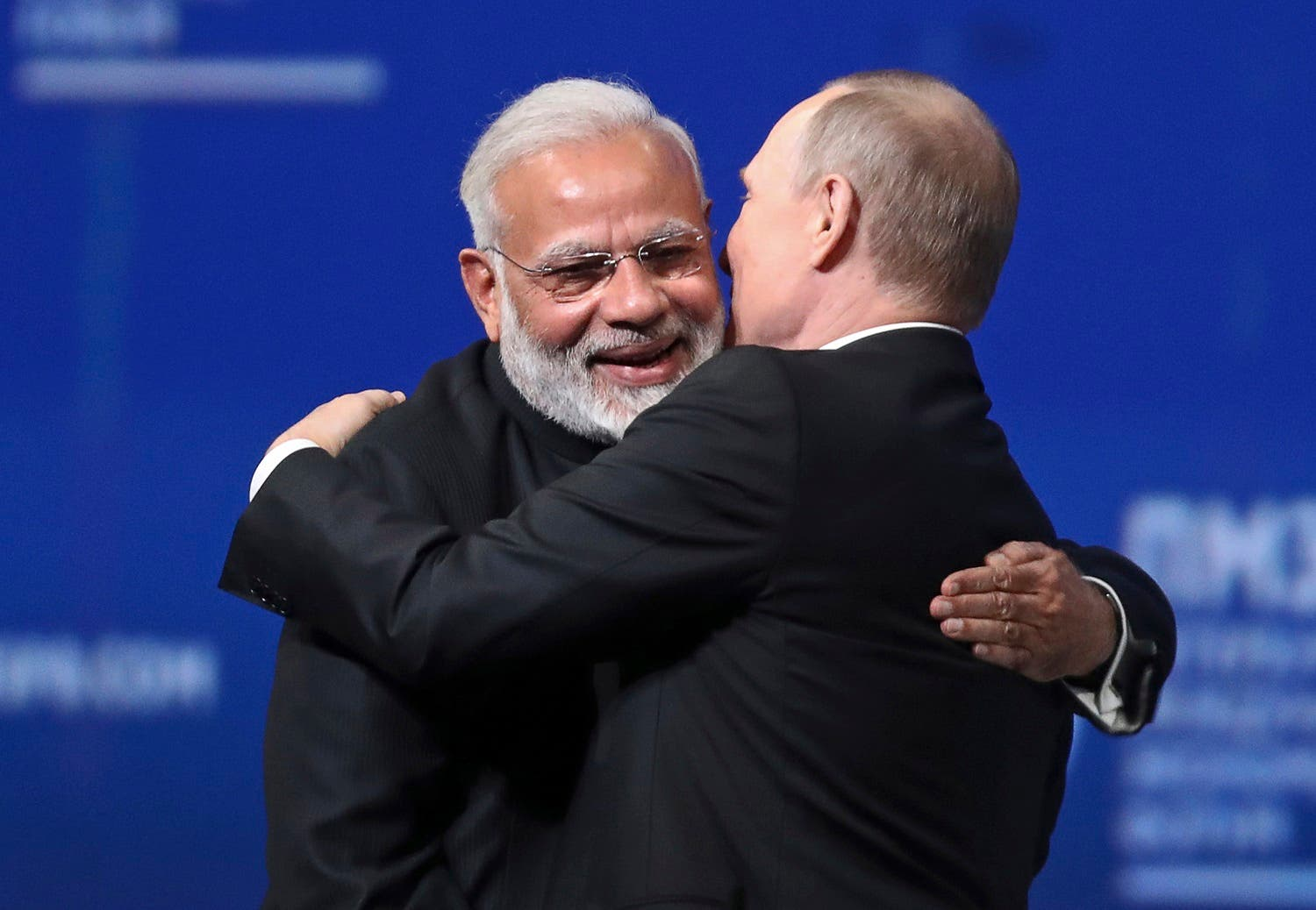 Vladimir Putin and Narendra Modi give each other a hug at the St. Petersburg International Economic Forum in St. Petersburg, Russia on June 2, 2017. (AP)