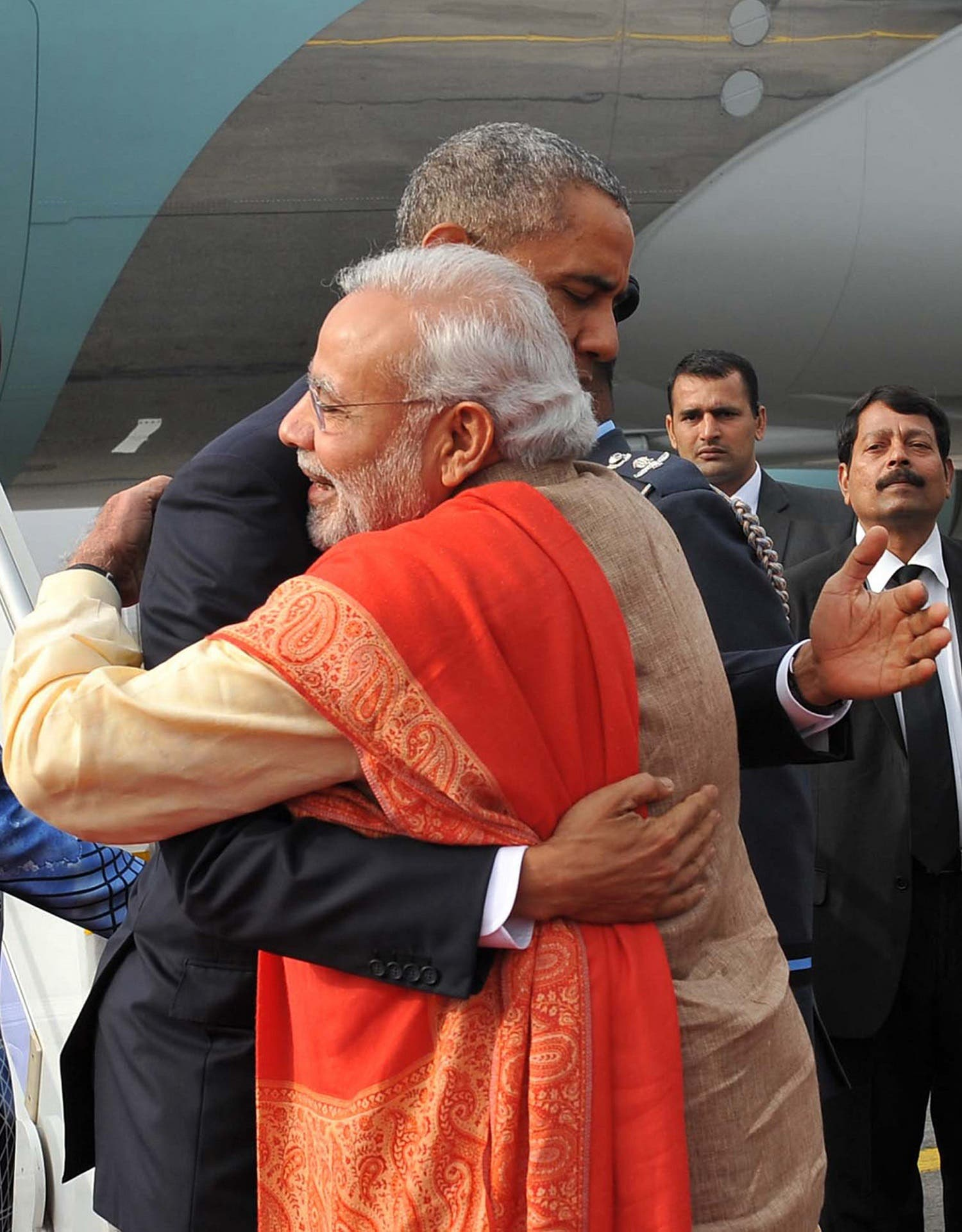 Modi and Obama hug as the then US president arrives in New Delhi on January 25. (AFP)