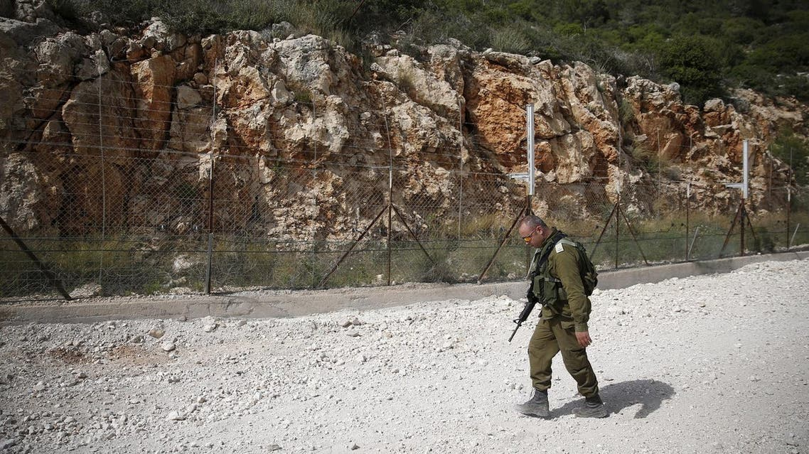 An Israeli soldier walks near the area where the Israeli army is excavating part of a cliff to create an additional barrier along its border with Lebanon, near the community of Shlomi in northern Israel April 6, 2016. Israeli Defence Forces (IDF) Lieutenant-General Eli David, who serves as an engineering officer in a northern division, told Reuters on Wednesday that the army began work on the new barrier by exposing the cliff in January 2015, to help protect communities located close to the Lebanese border from infiltrators. REUTERS/Ronen Zvulun TPX IMAGES OF THE DAY