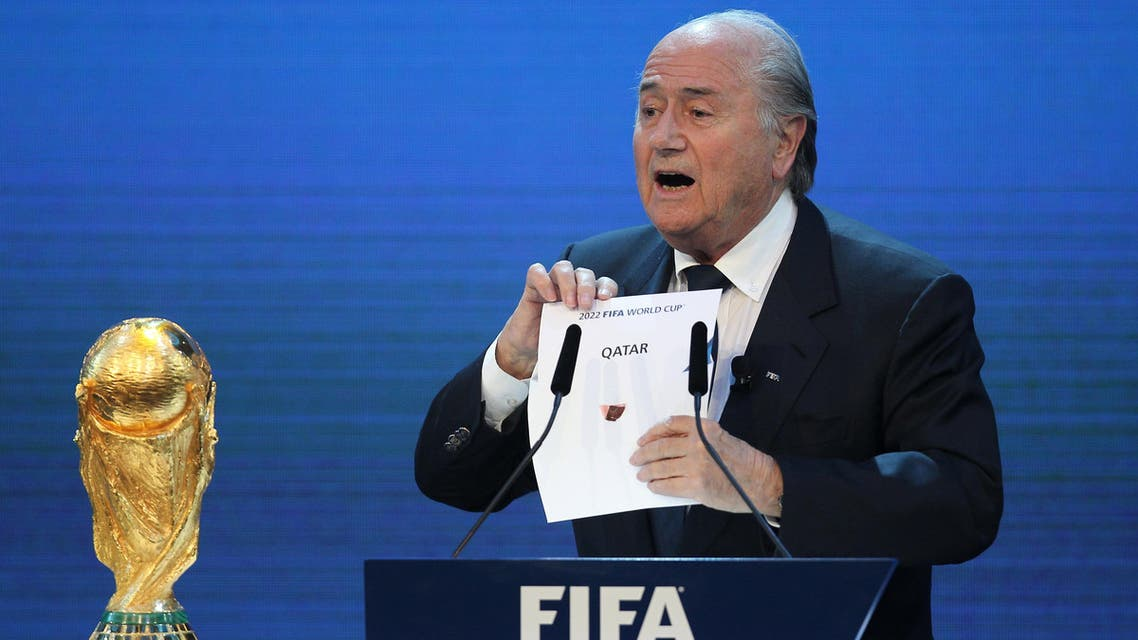 FIFA president Joseph Blatter opens the envelope to reveal that Qatar will host the 2022 World Cup at the FIFA headquarters in Zurich on December 2, 2010. Qatar became the first Arab, Middle Eastern or Muslim country to be awarded the right to stage football's World Cup. AFP PHOTO/KARIM JAAFAR