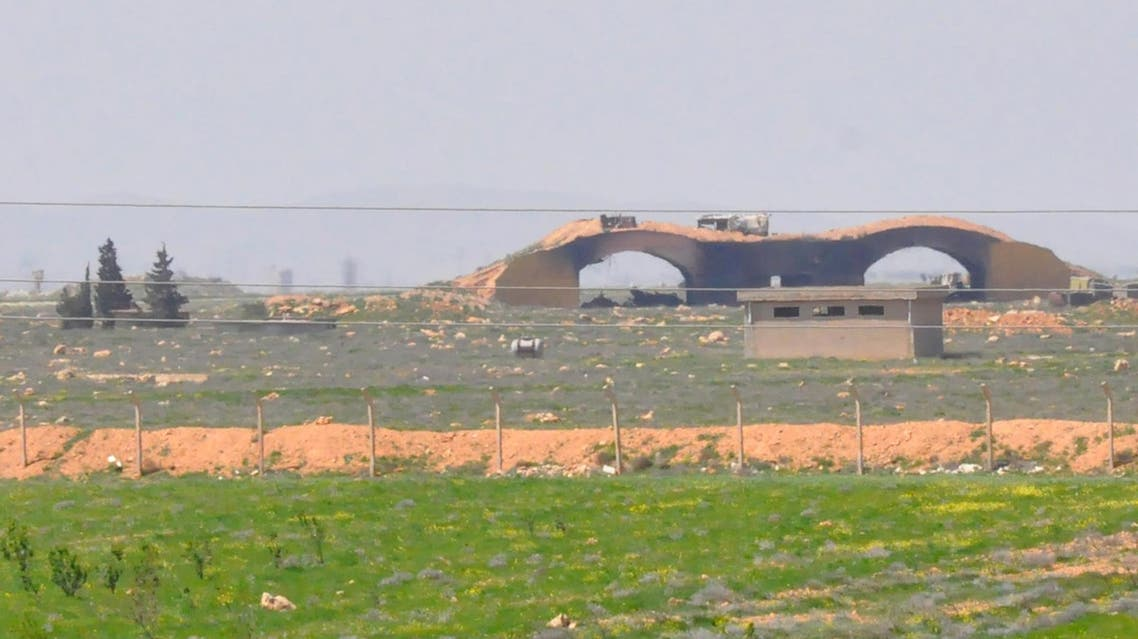 "A picture taken on April 7, 2017 shows a view of the damaged Shayrat (""ash-Shairat"") airfield at the Syrian government forces military base targeted earlier overnight by US Tomahawk cruise missiles, southeast of the central and third largest Syrian city of Homs."