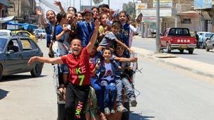 أطفال عراقيون يحتفلون بعيد الفطر غرب الموصل