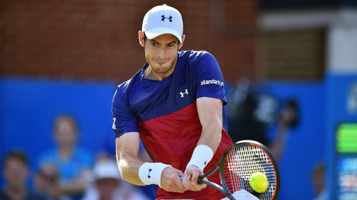 Britain's Andy Murray returns to Australia's Jordan Thompson during their men's singles first round tennis match at the ATP Aegon Championships tennis tournament at Queen's Club in west London on June 20, 2017. Murray lost the match 6-7, 2-6. (AFP)