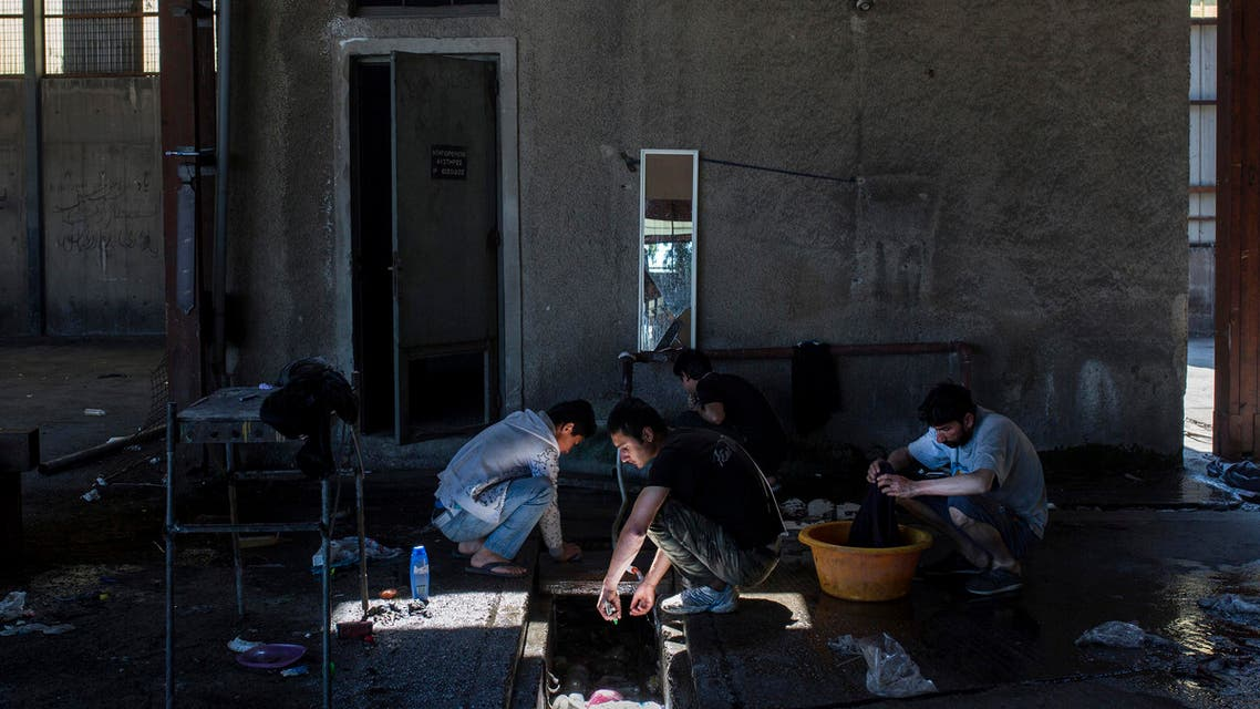 Migrants find shelter in an abandoned factory in Greece