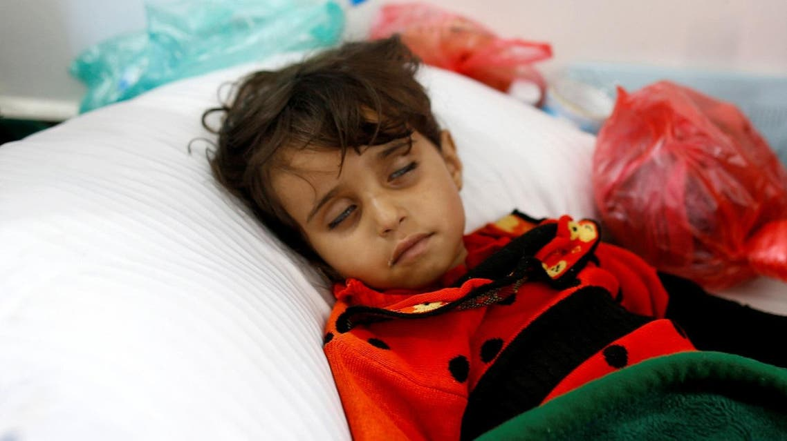 A girl infected with cholera lies on the ground at a hospital in Sanaa, Yemen May 7, 2017. Picture taken May 7, 2017. REUTERS