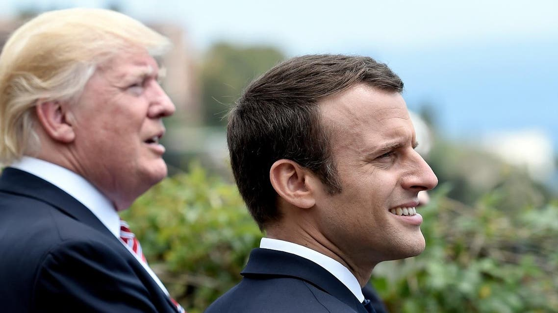 US President Donald Trump (L) and French President Emmanuel Macron watch an Italian flying squadron as they attend the Summit of the Heads of State and of Government of the G7, the group of most industrialized economies, plus the European Union, on May 26, 2017 in Taormina, Sicily. The leaders of Britain, Canada, France, Germany, Japan, the US and Italy will be joined by representatives of the European Union and the International Monetary Fund (IMF) as well as teams from Ethiopia, Kenya, Niger, Nigeria and Tunisia during the summit from May 26 to 27, 2017. (AFP)