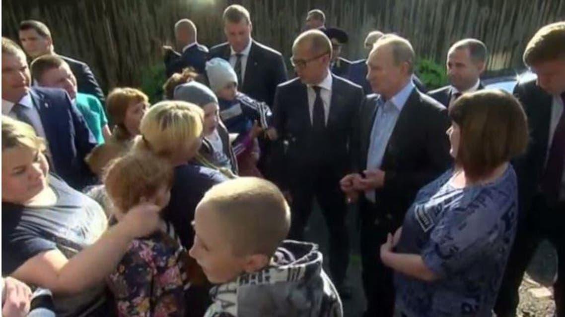 بوتين أثناء الزيارة
