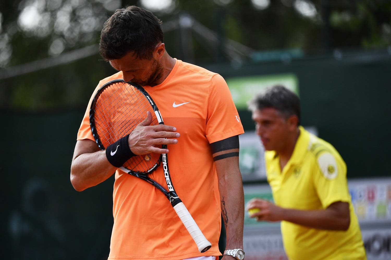 AC Milan's former player Paolo Maldini (L) reacts during the men's doubles tennis match, with his partner Stefano Landonio against Poland's player Tomasz Bednarek and Nederland's player David Pel during the ATP Challenger Tour on June 27, 2017 at the Aspria Tennis Club in Milan. Marco BERTORELLO / AFP