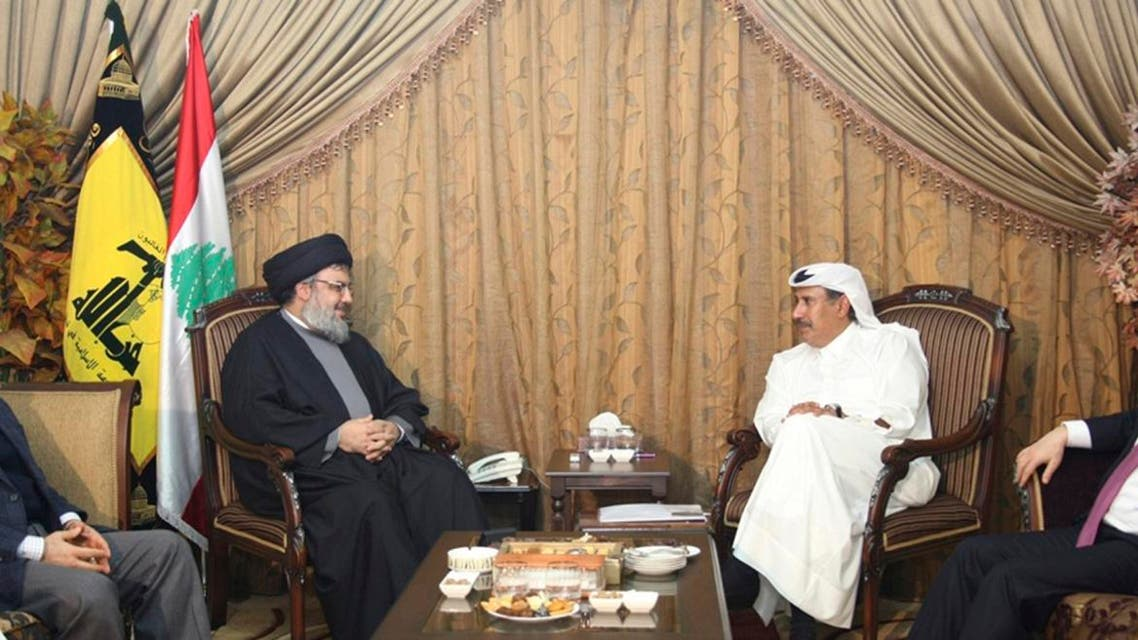 Hezbollah leader Sayyed Hassan Nasrallah (2nd L) speaks with Qatar's Prime Minister and Foreign Minister Sheikh Hamad bin Jassim bin Jaber al-Thani (2nd R), as Turkey's Foreign Minister Ahmet Davutogluat (R) and Hezbollah official Hussein al-Khalil listen during their meeting in Beirut, January 18, 2011. reuters