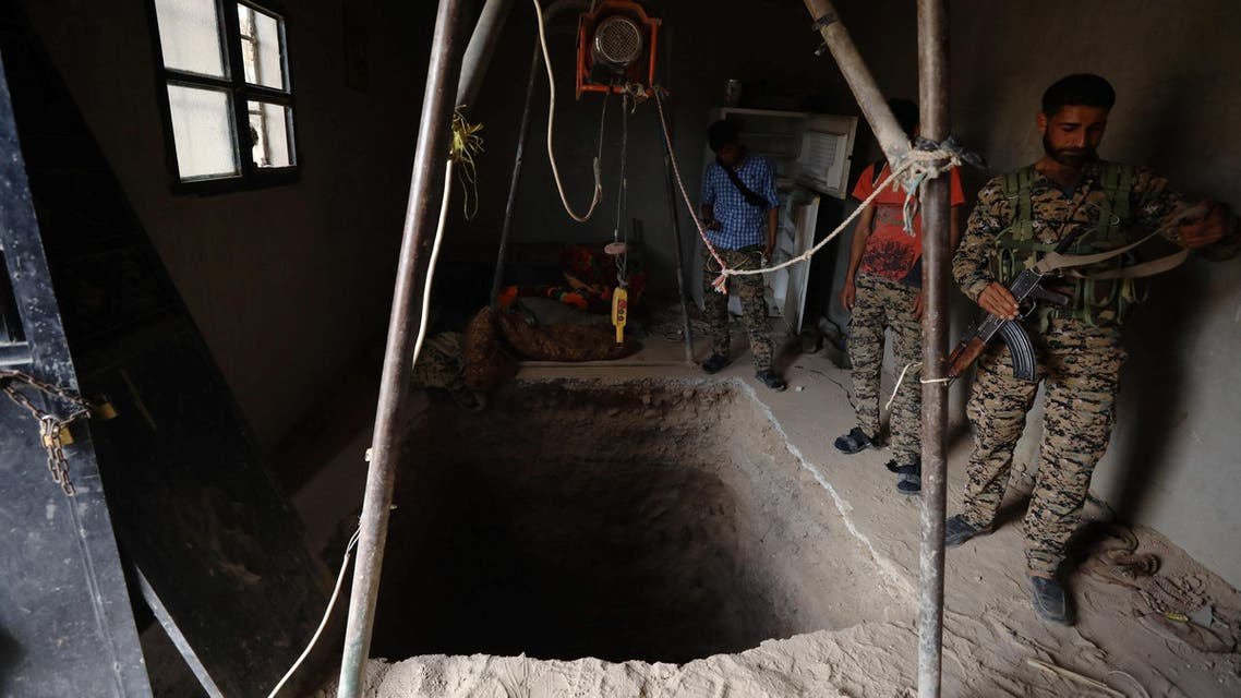 Syrian Democratic Forces (SDF) fighters inspect a tunnel dug by Islamic State militants inside a house in the Raqqa's al-Sanaa industrial neighbourhood. (Reuters)